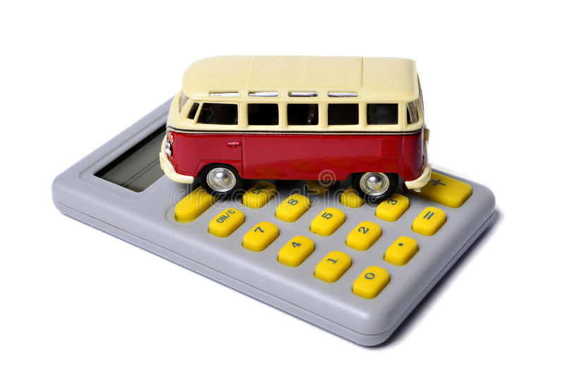 Miniature minivan on a calculator. Isolated on white, concept stock photography