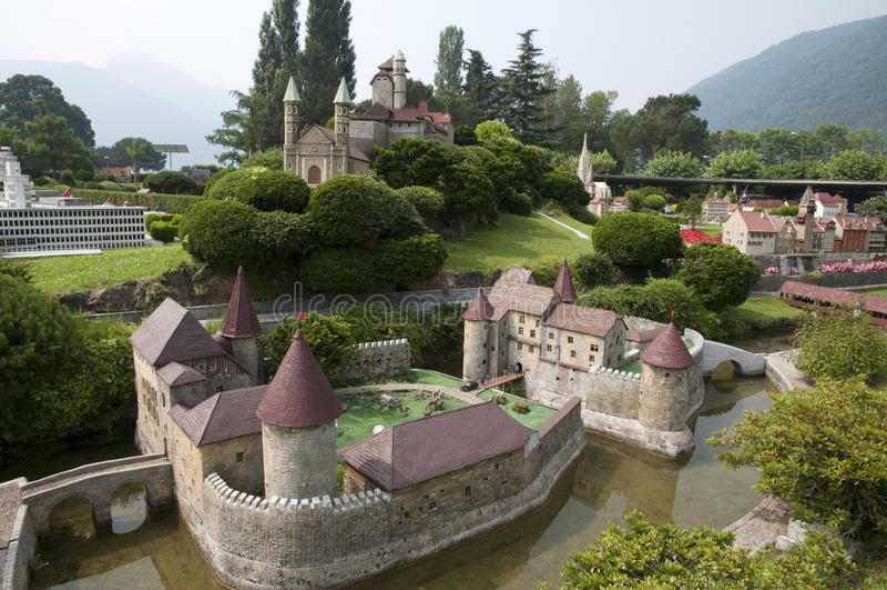 Miniature model (castle) in mini park. Miniature model (castle) of mountain village in mini park (Europe, Switzerland, Lugano royalty free stock photo