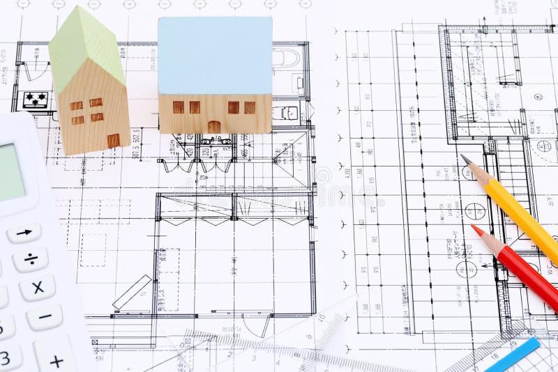 Miniature model of house on blueprints stock image image of download miniature model of house on blueprints stock image image of construct blueprint malvernweather Choice Image