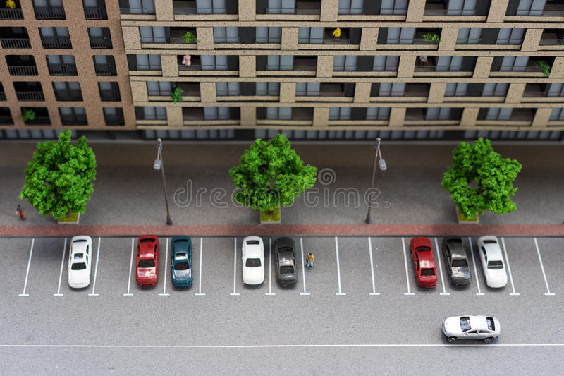 Miniature model, miniature toy buildings, cars and people. City maquette. stock photos