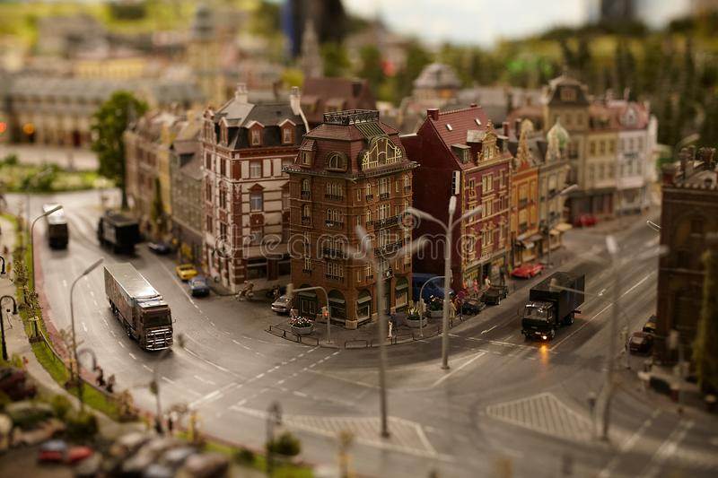 Miniature models figure cars and trucks at the city street royalty free stock image