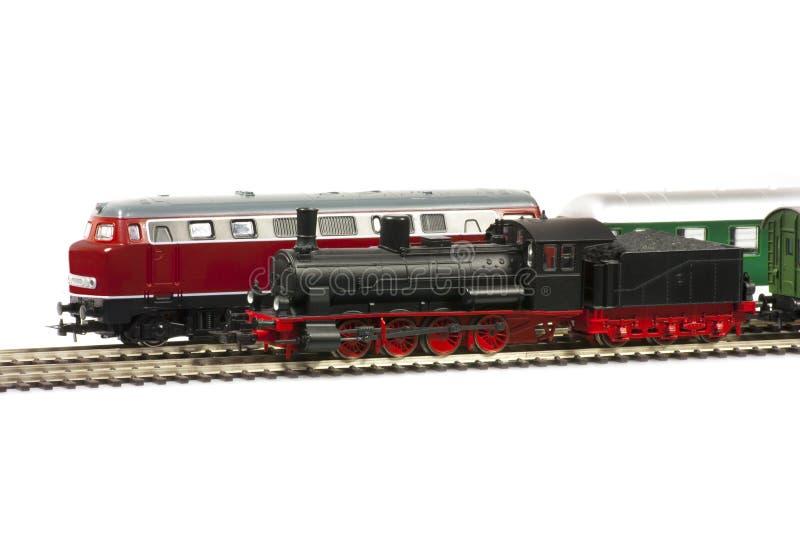 Miniature models of trains. Isolated on white background stock image