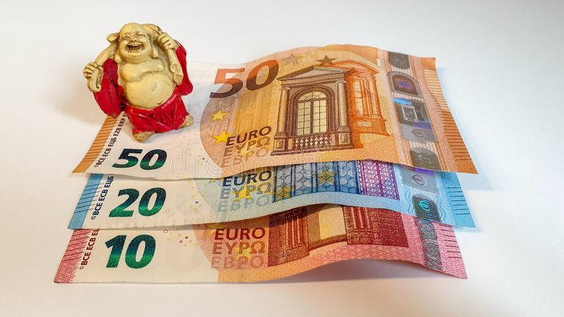 Miniature monk with money, currency Euro royalty free stock photography