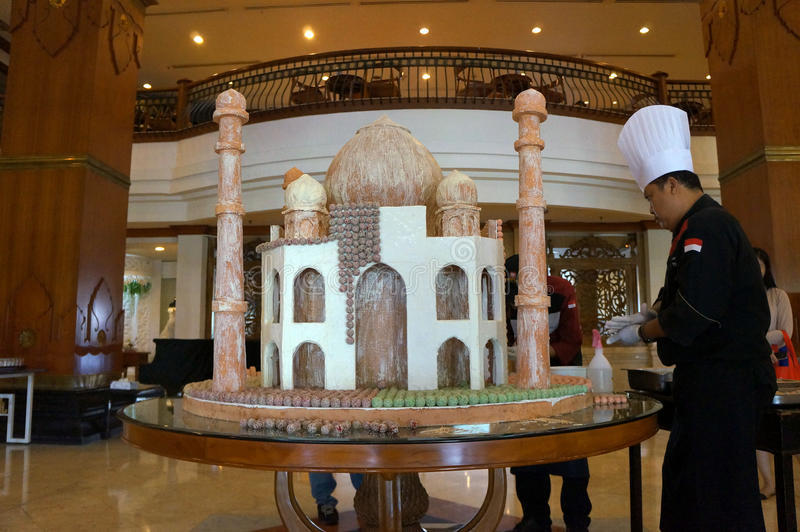 Miniature mosque. The cook was making a miniature mosque of thousands of traditional cakes at a hotel in the city of Solo, Central Java, Indonesia stock images