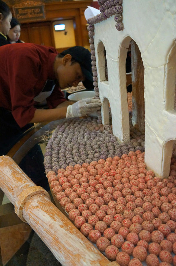 Miniature mosque. The cook was making a miniature mosque of thousands of traditional cakes at a hotel in the city of Solo, Central Java, Indonesia stock image