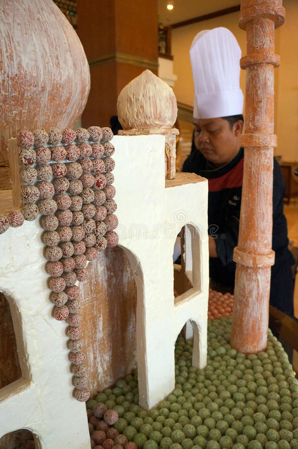 Miniature mosque. The cook was making a miniature mosque of thousands of traditional cakes at a hotel in the city of Solo, Central Java, Indonesia royalty free stock image