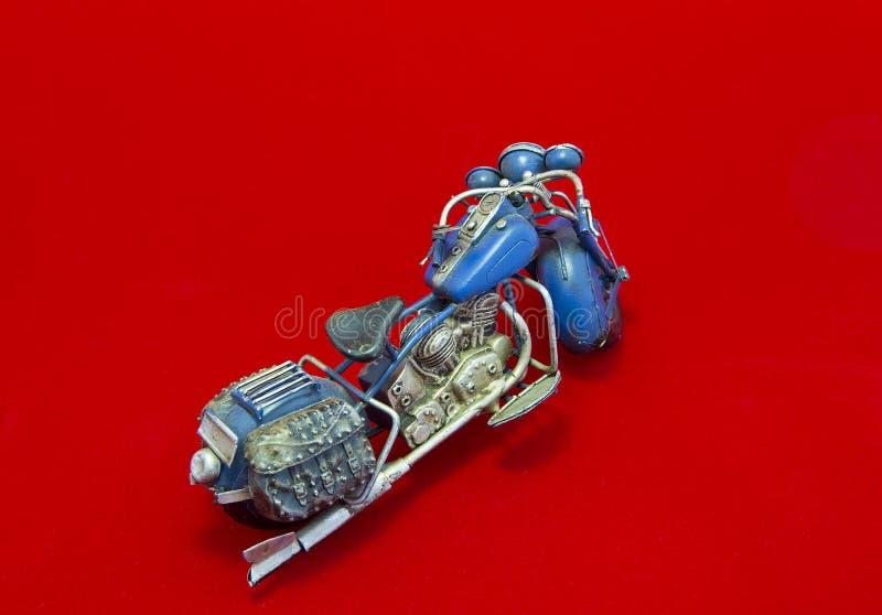 Download Miniature Motorcycle On Red Background Stock Photo - Image of saddle, saddlebag: 36878742