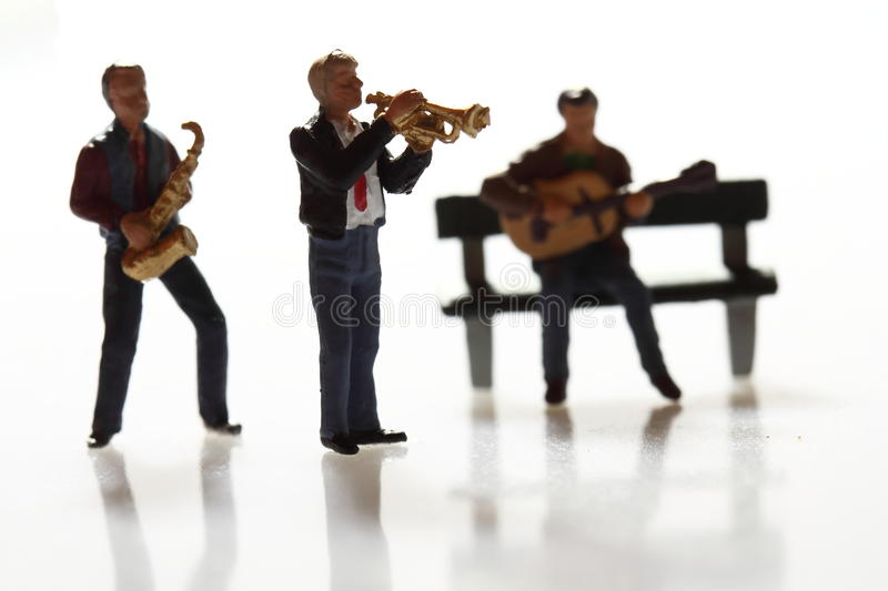 Miniature musicians B. Miniature models of a street band performing royalty free stock photo