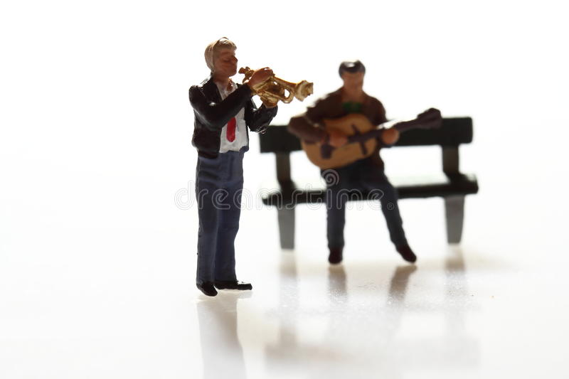 Miniature musicians A. Miniature models of a street band performing royalty free stock photography