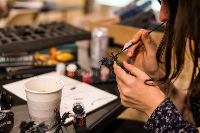 Miniature painting at a Games Workshop store stock image