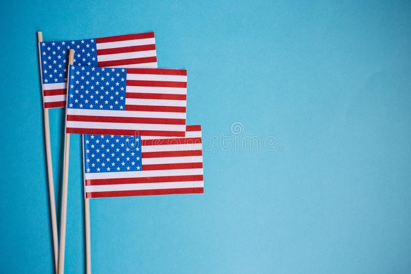 Miniature paper flags USA. American Flag on rustic wooden background stock image