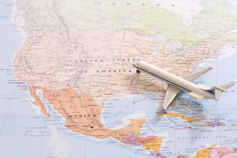 Miniature of passenger airplane on a map, travel destination USA. Miniature of a passenger plane flying on the map of United States of America from south east royalty free stock image