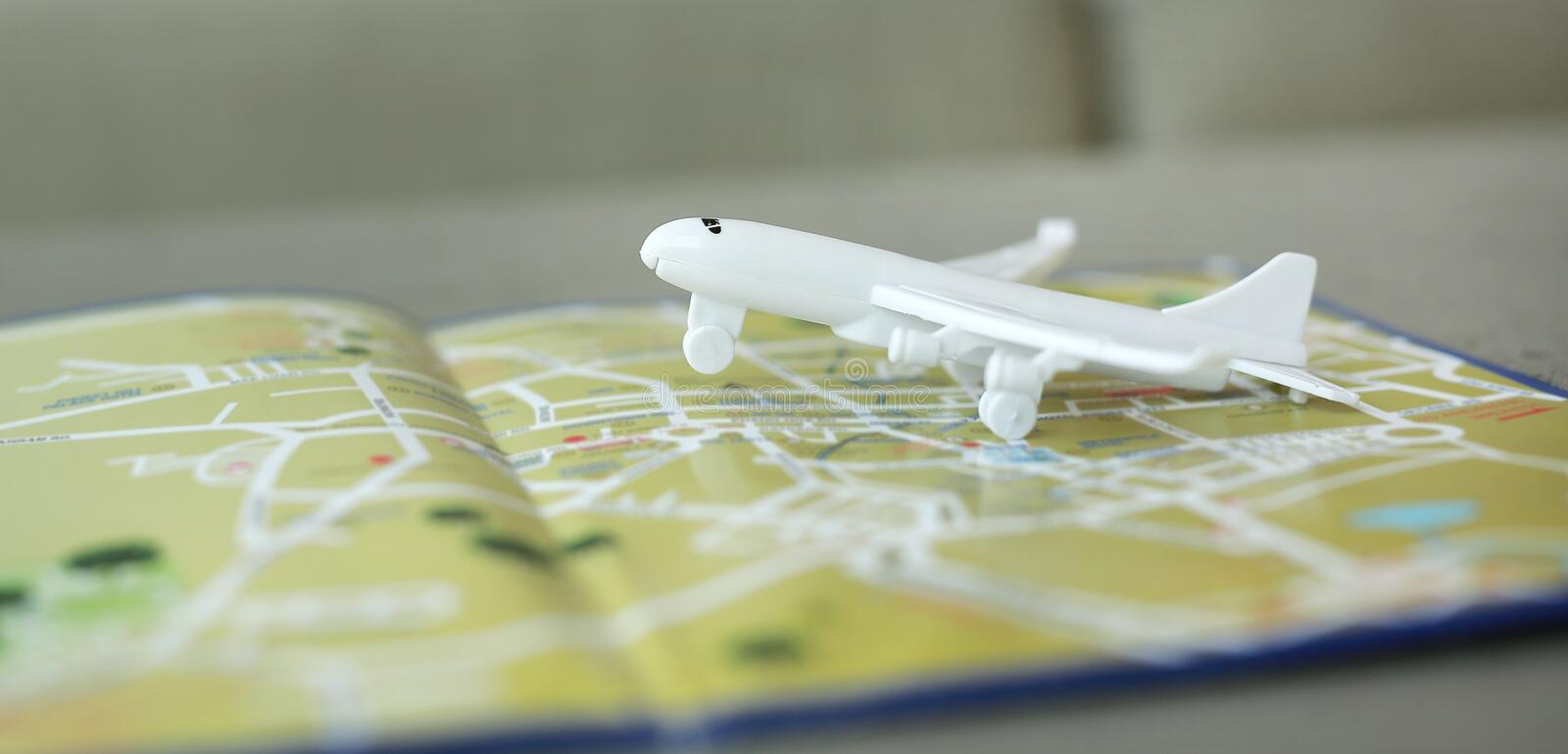Miniature of a passenger plane flying on the map. Conceptual image for tourism and travel royalty free stock photos