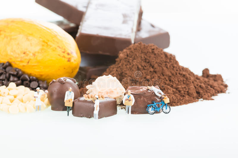 Miniature pastry chefs and cocoa royalty free stock photos