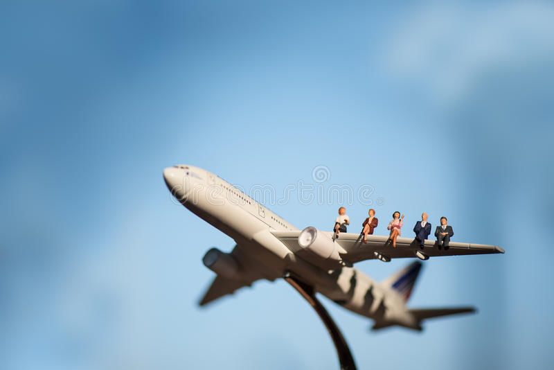 Miniature people on airplane using as background travel royalty free stock image