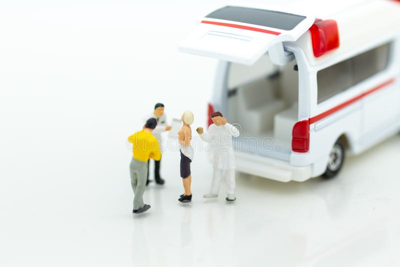 Miniature people : ambulance for treatment of patients far from medical facilities. Image use for health care concept royalty free stock photos