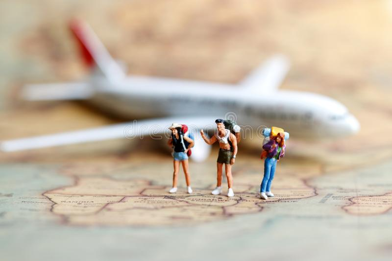 Miniature people: backpacker with airplane, travel and business stock photo