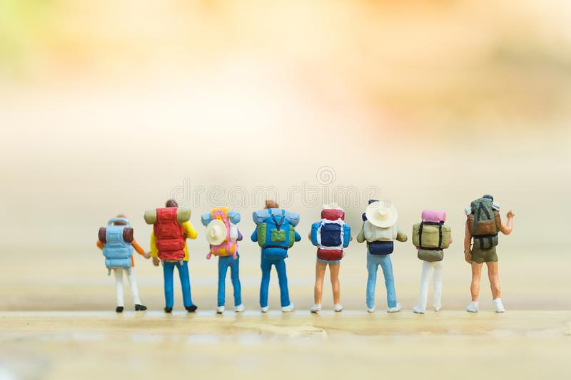 Miniature people : Backpacker Traveling as a team, using as travel adventure concept. royalty free stock image