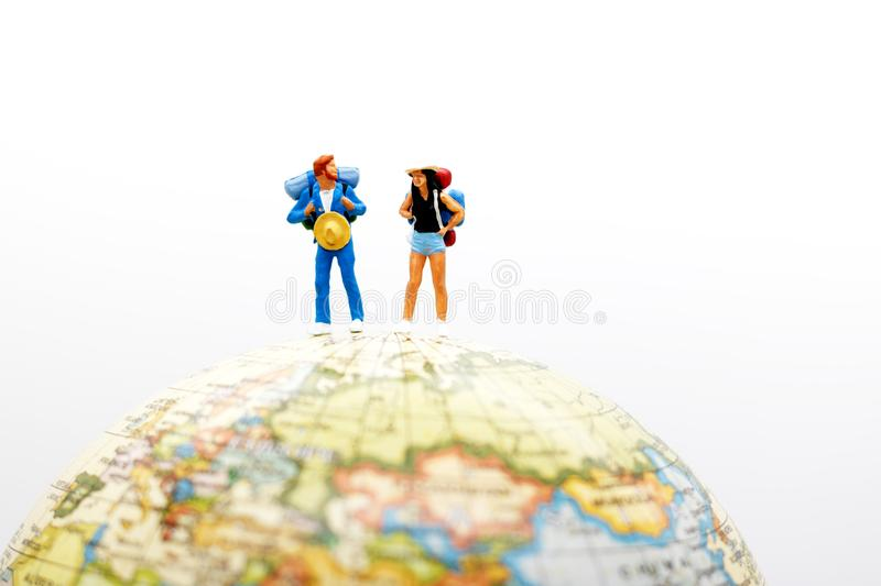 Miniature people, backpackers on the globe walking to destination. travel and business concept. stock photography