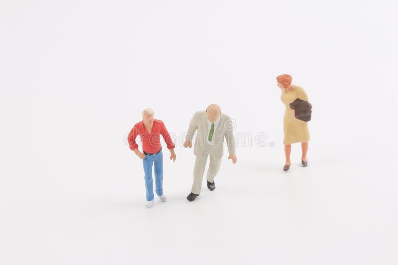 Miniature people on the board. Toys of mini people at the fun mini world stock photo