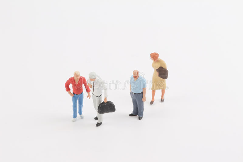 Miniature people on the board. Toys of mini people at the fun mini world royalty free stock photography