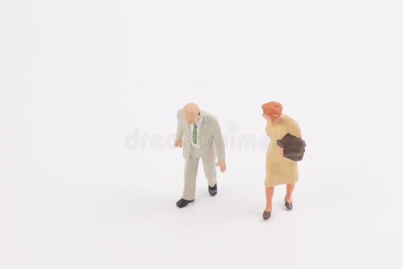 Miniature people on the board. Toys of mini people at the fun mini world royalty free stock photo