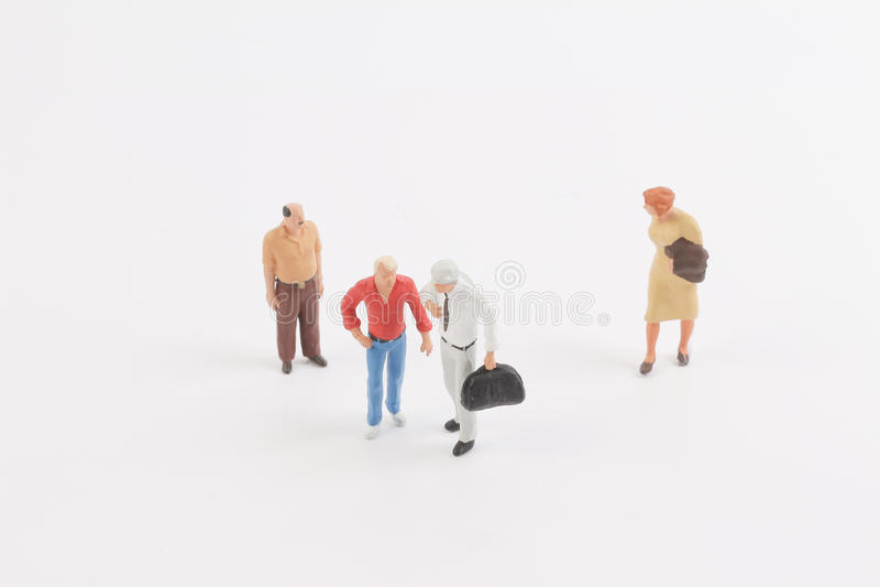 Miniature people on the board. Toys of mini people at the fun mini world stock photography