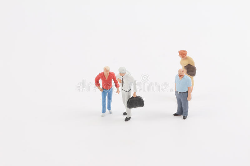 Miniature people on the board. Toys of mini people at the fun mini world royalty free stock image