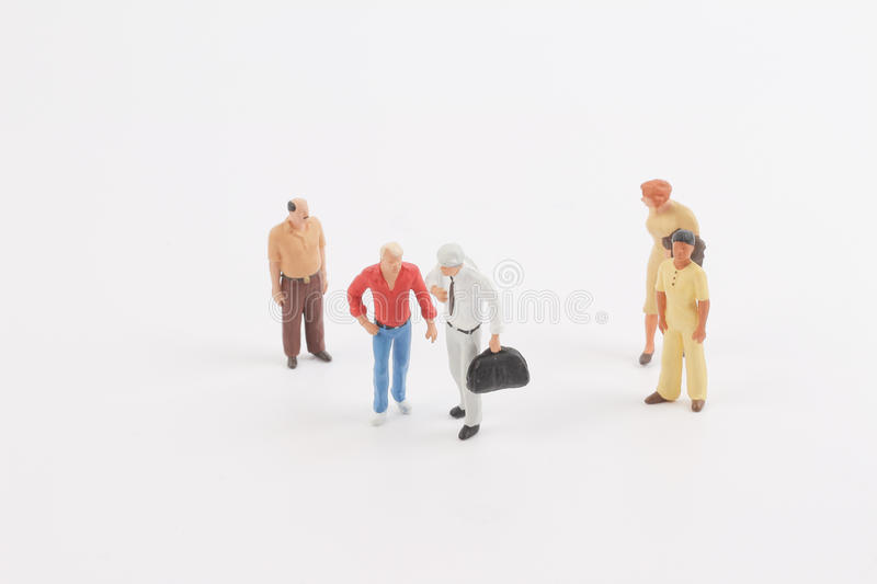 Miniature people on the board. Toys of mini people at the fun mini world stock images