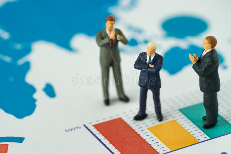 Miniature people business concept as small figure businessmen st. Anding on analysis graph chart and others clapping stock photos