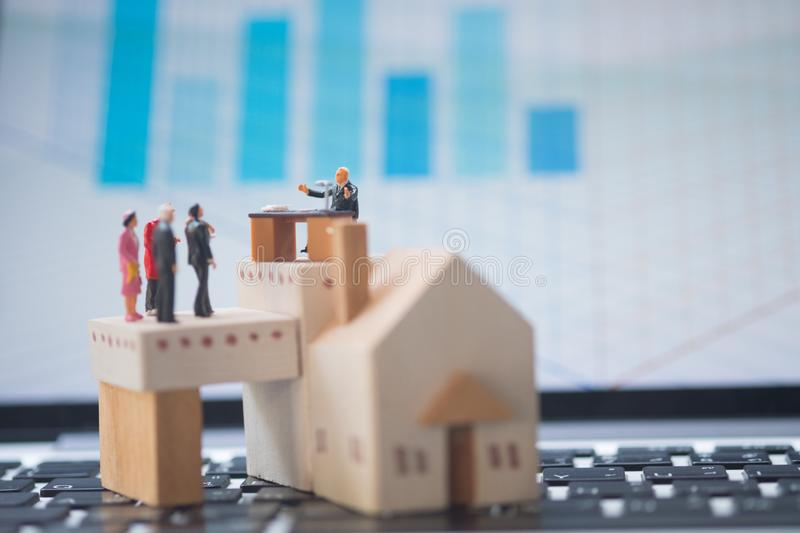 Miniature people: Business consultants on financial transactions for home loan stock images