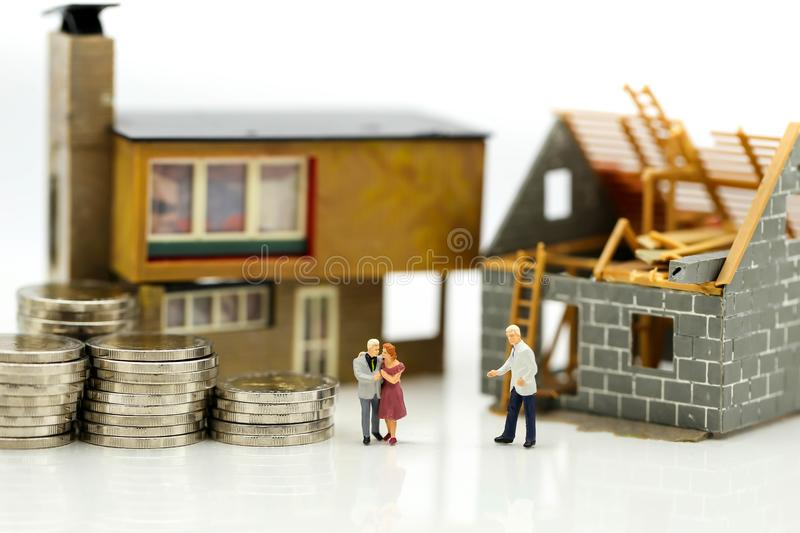 Miniature people : Business meeting with coins stack and home re royalty free stock photos
