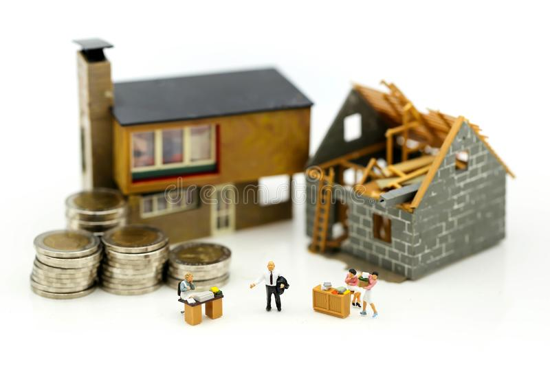 Miniature people : Business meeting with coins stack and home re royalty free stock image