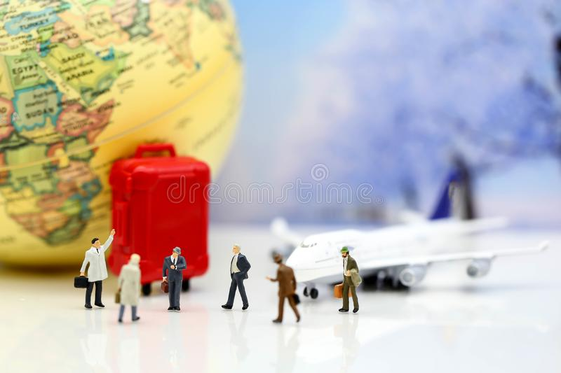 Miniature people : Businessman with airplane,worldmap,luggage of royalty free stock photo