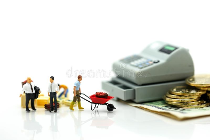 Miniature people : Businessman and construction worker with money,coins,contract of Business Construction concept. royalty free stock photos