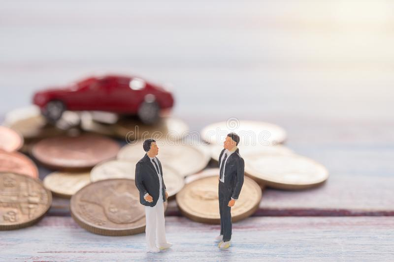 Miniature people : Businessman figures standing on the floor wit stock photography