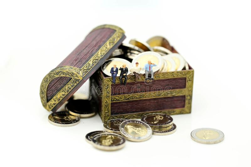 Miniature people : businessman found the treasure of gold coins stock photo