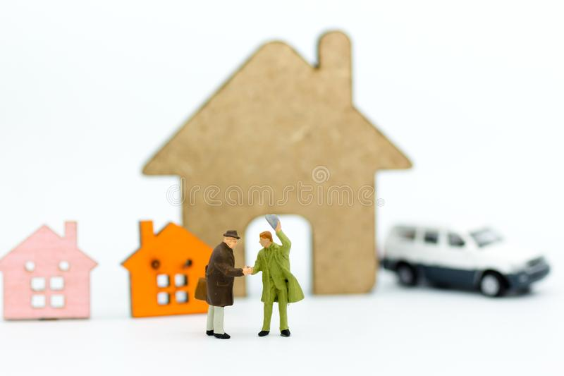 Miniature people: Businessman make deal for loan ,buy house. Image use for finance, business concept royalty free stock photo