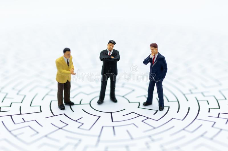 Miniature people : Businessman in the maze. Image use for risk, finding solution for solve problem.  stock photography