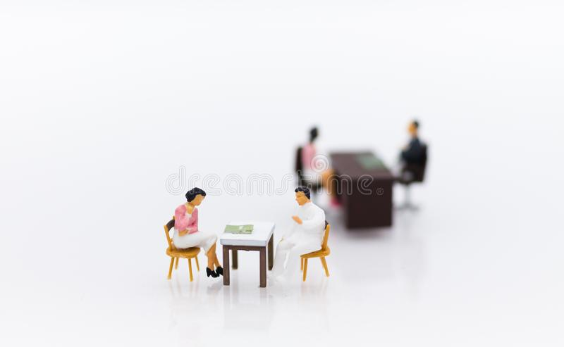 Miniature people : Businessman meeting with employee for job interviews, job vacancies. Image use for reducing unemployment rate.  royalty free stock photography
