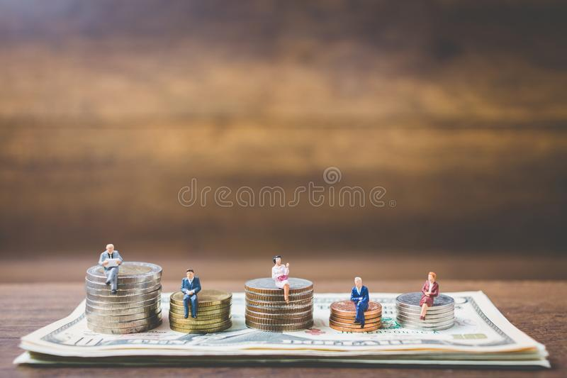Miniature people businessman on money royalty free stock photo