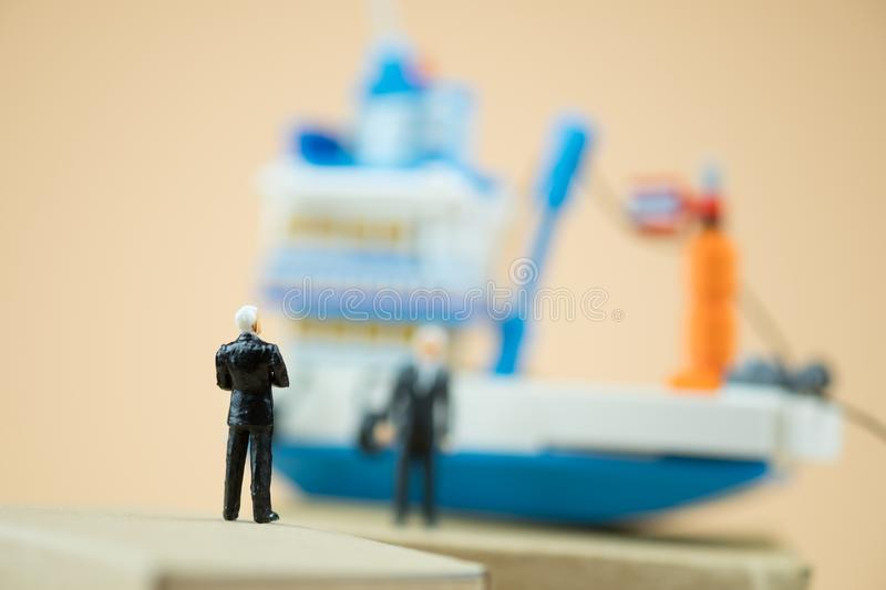 Miniature people : businessman negotiate global business logistics import export royalty free stock photography