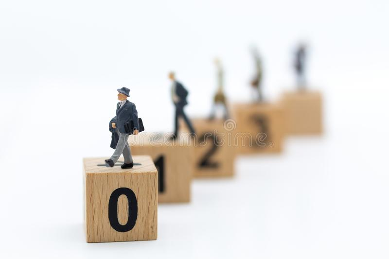 Miniature people: Businessman stand in order, ability of the person. Image use for work progress, business concept.  stock image