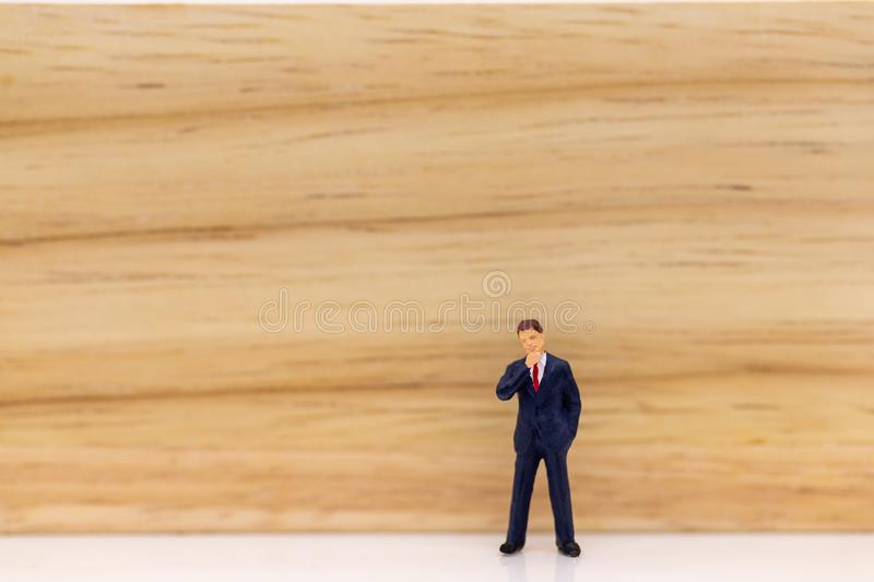 Miniature people: Businessman stand with think space area. Image use for business concept, new idea.  stock photos