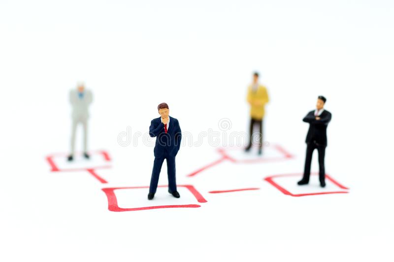 Miniature people: Businessman stand in various positions. Image use for business cycle, responsibility.  stock photo