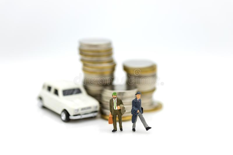 Miniature people : Businessman standing with car. Image use for Advertising product in the market today. Miniature people : Businessman standing with car. Image royalty free stock photo