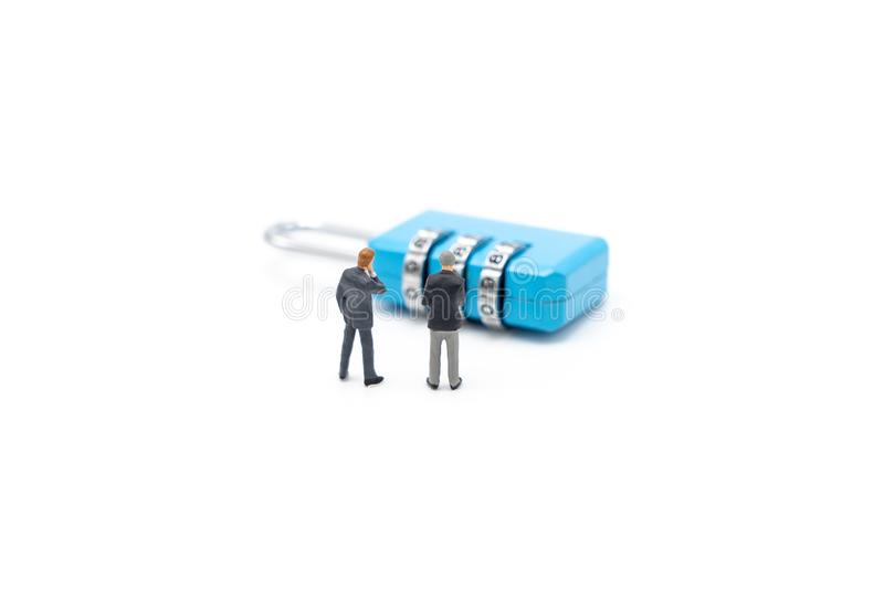 Miniature people businessmen analyze password From the blue key as background business concept and Security concept with copy. Space stock images