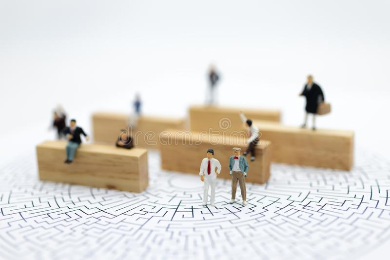 Miniature people : Businessmen are looking for a solution and teamwork. Image use for solve problems and new idea concept.  stock images