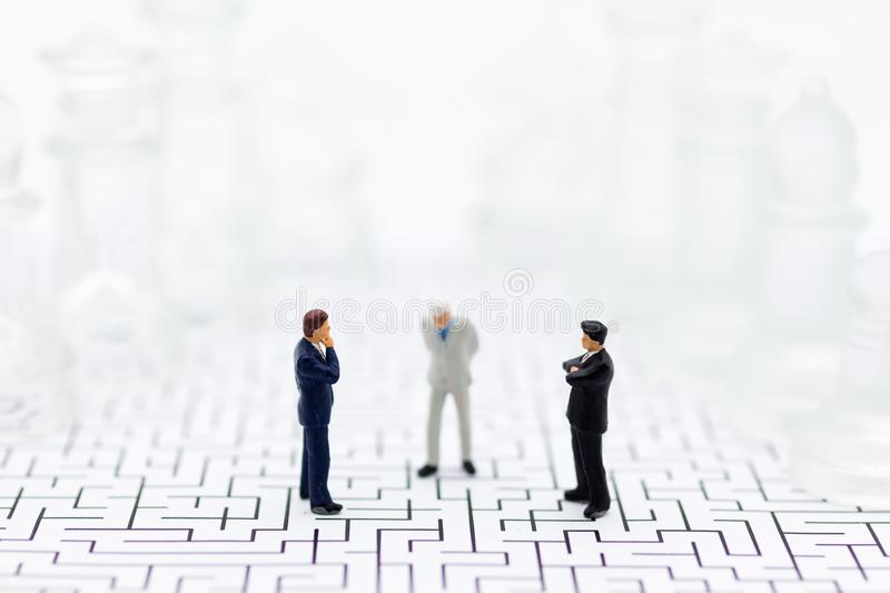 Miniature people, Businessmen stand on opposite sides of the chess game, separate party , benefit, use as a business competition royalty free stock photos