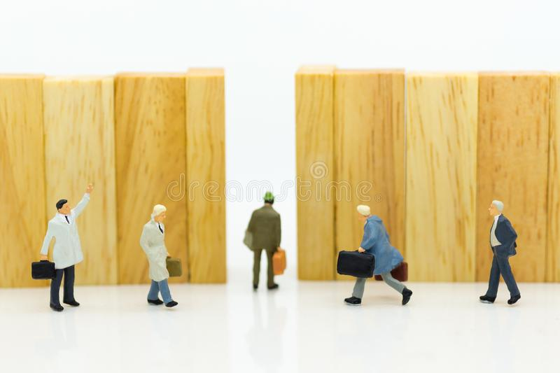 Miniature people : Businessmen are walking to the exit point. Image use for the best choice of choose, business concept royalty free stock photos